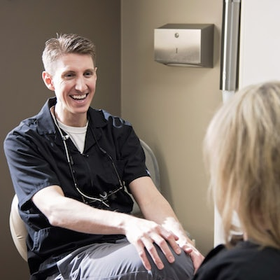 Norfolk Dental Clinic - Dr. Karmazin chatting with a patient
