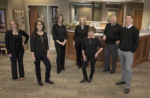 Norfolk Dental Team standing in the office.