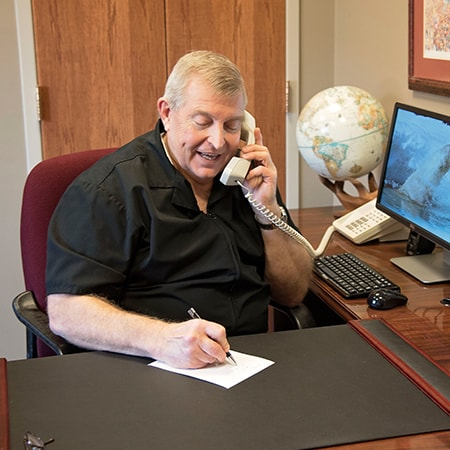 Your lead Norfolk Dental Care expert on the phone to a patient